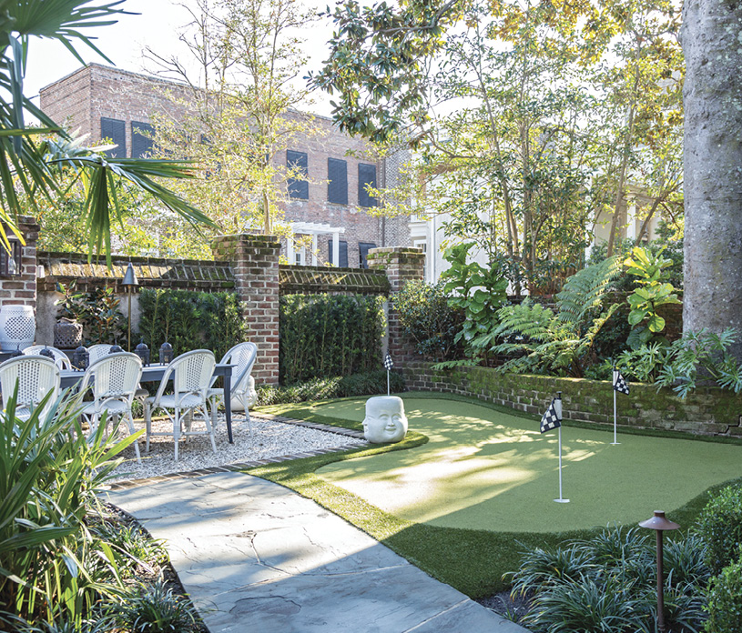 ...while the outdoor dining table overlooks a green, ideal for a little post-dinner putting.