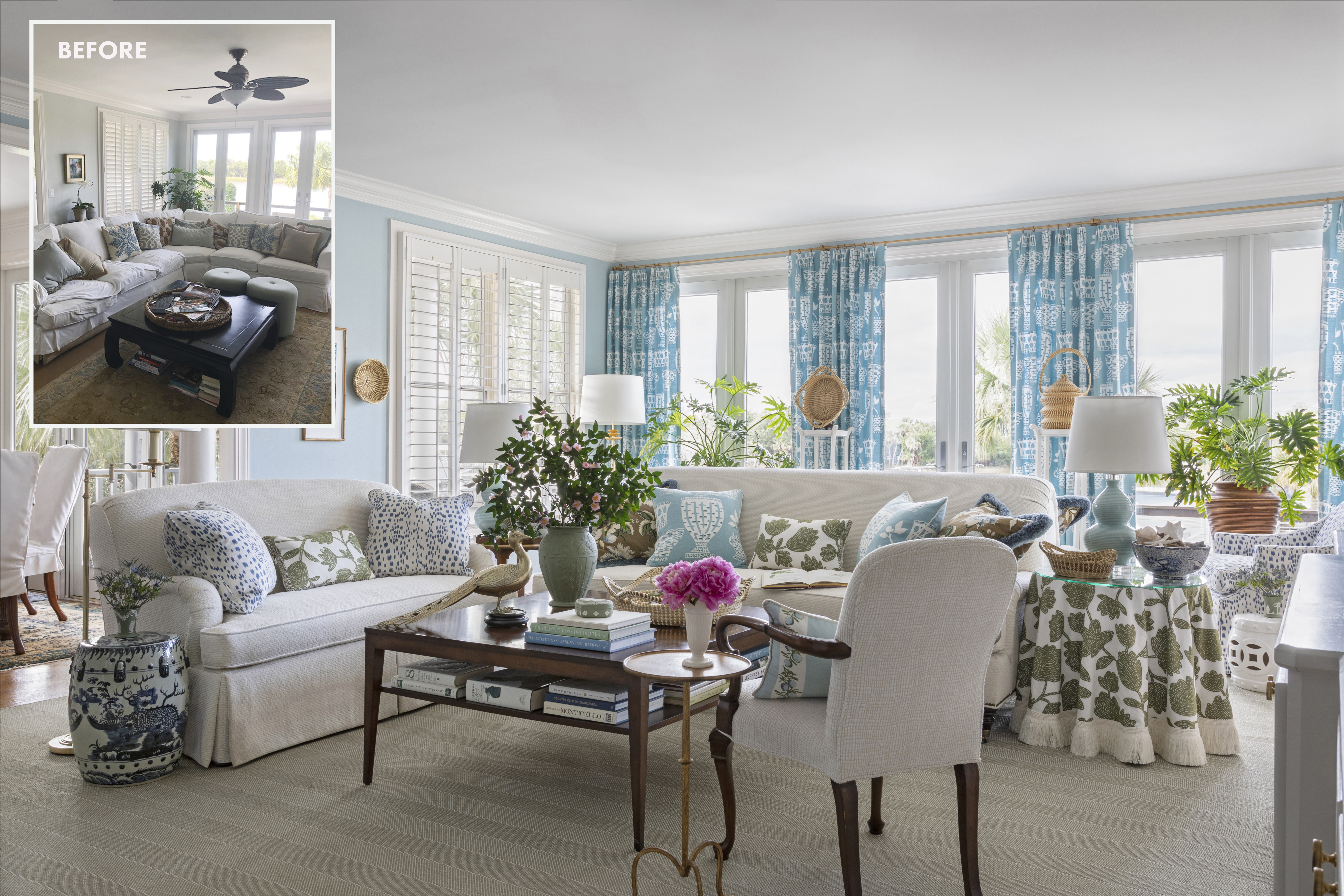"""COASTAL HUES: A palette of blues and greens, inspired by the marsh and Intracoastal Waterway views, was infused into this now light and bright living room through custom pillows in a variety of fabrics and trims. The pattern play pulls from and contrasts with the Charlotte Moss """"Caroline"""" drapes that dominate the room, changing in scale and function as it moves from the drapes to the sofas..."""