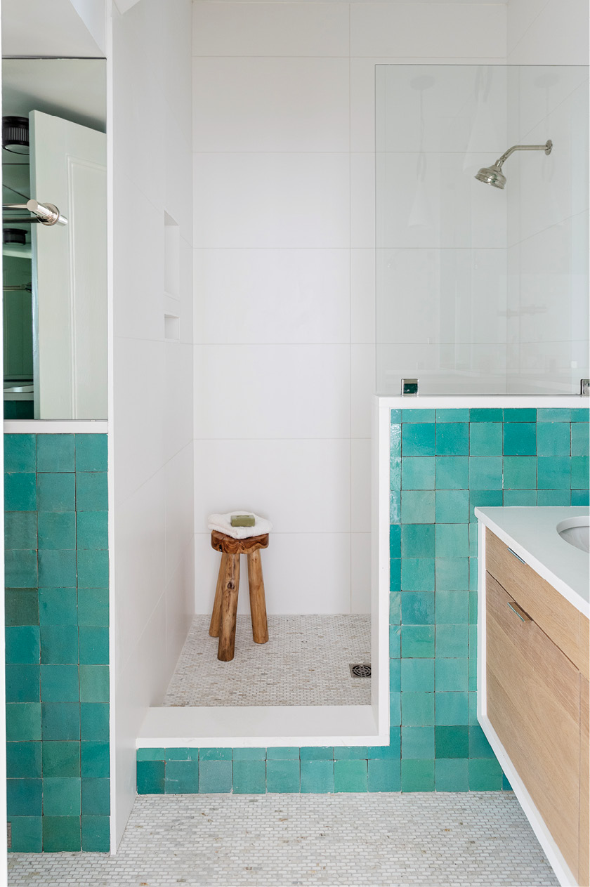 A few steps from there, the guest bathroom adds a splash of color with handmade Moroccan tile from Mosaic House.