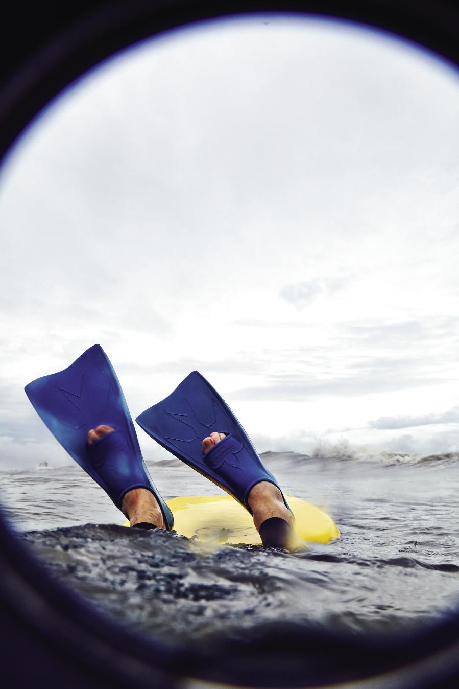 Photographer Peter Frank Edwards dives under a wave.