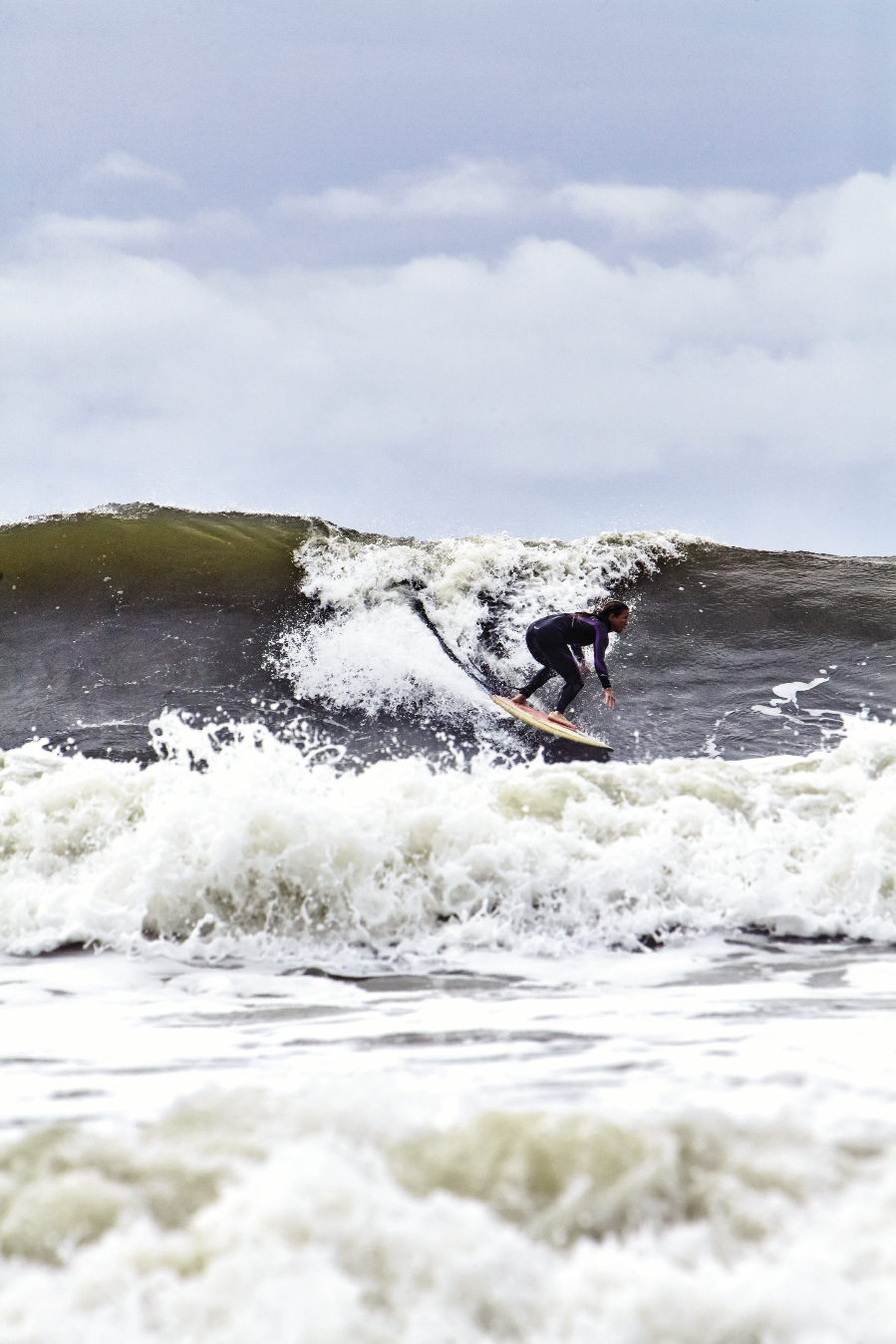 Jenny Brown takes off on an offshore peak.