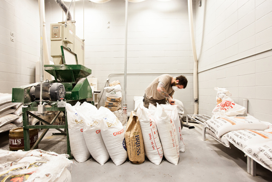 Mike Levin preparing to mill grain for the next batch