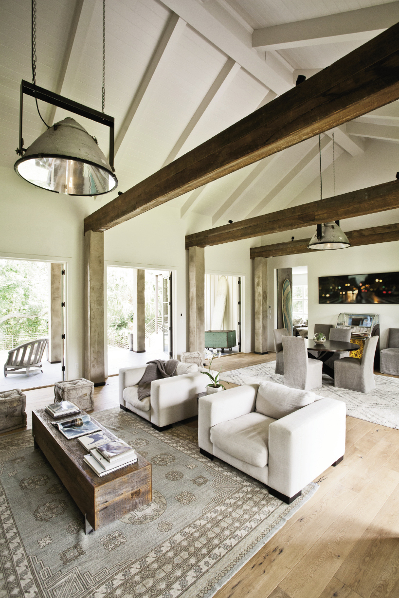 Three oversize sets of French doors join the lofty central room to the outdoors.