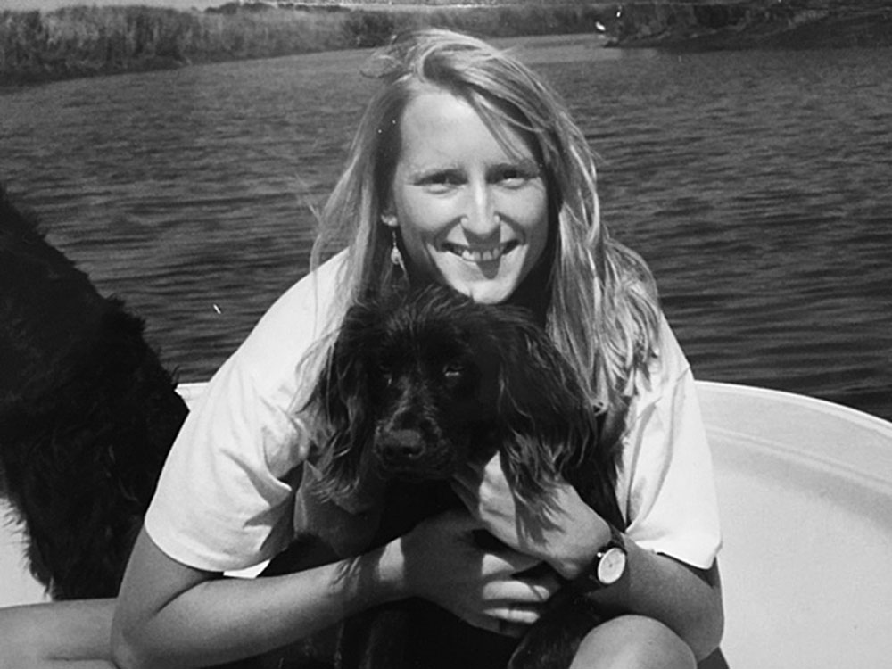 In her 20s with Boykin spaniel Rudy