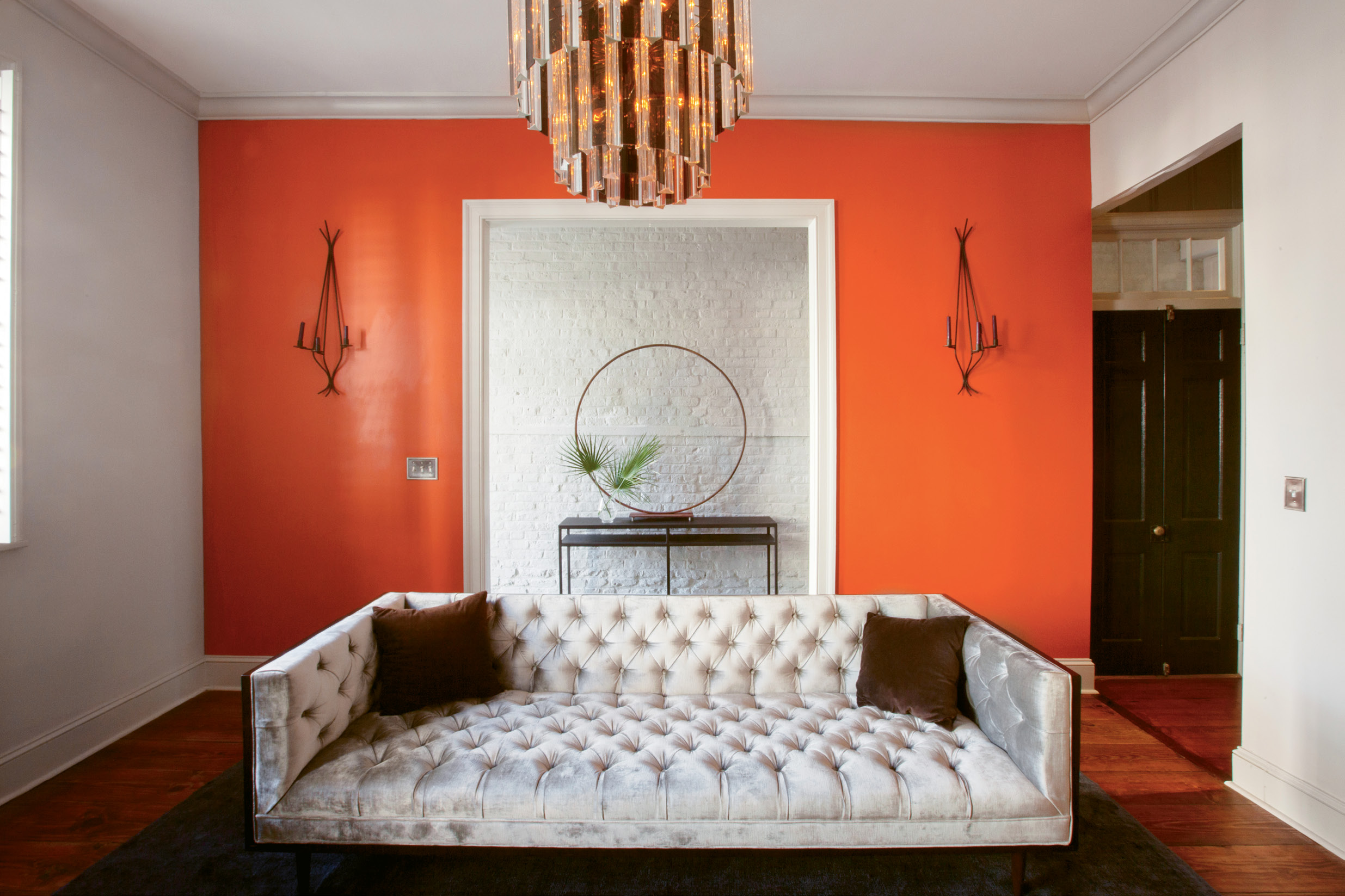 "A bold accent wall In Benjamin Moore's ""Fire Dance"" enlivens the living room ."