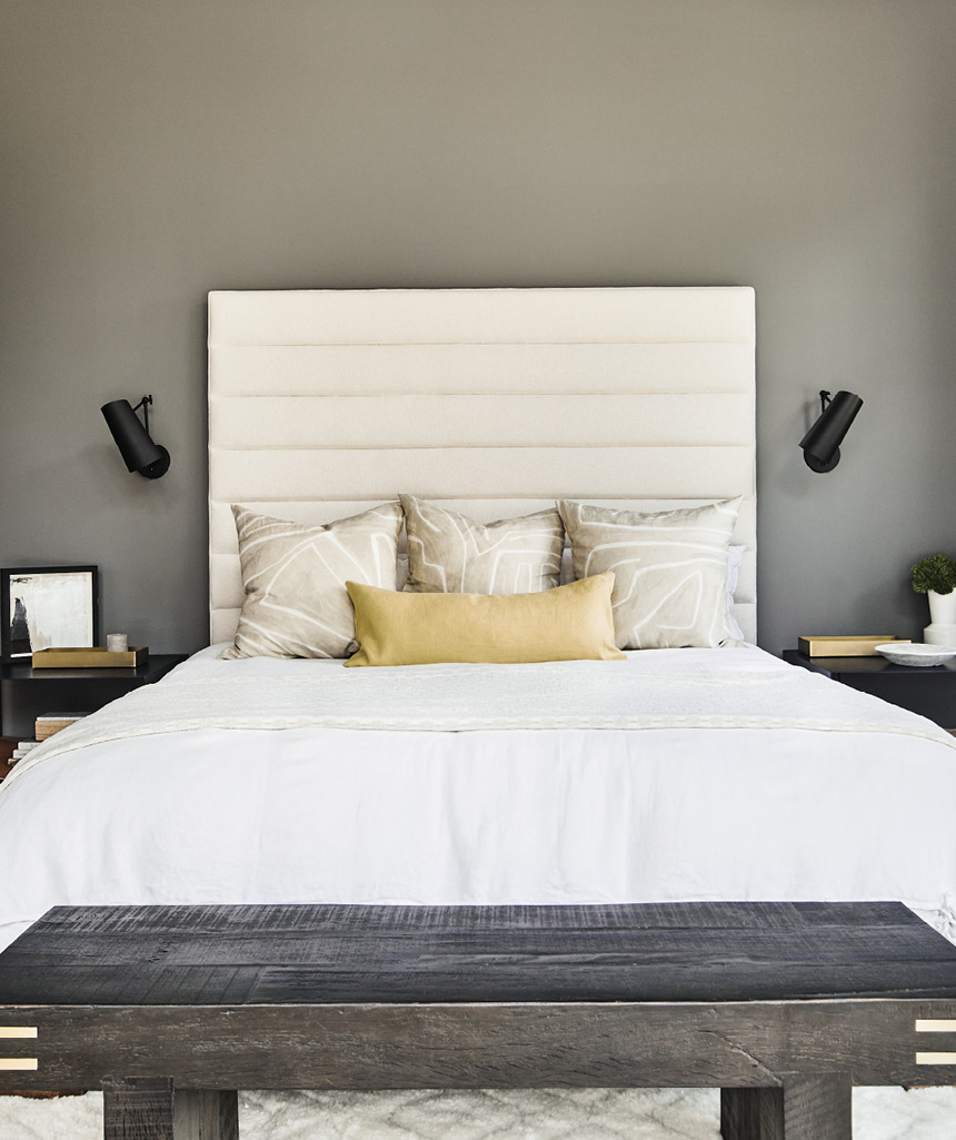 Jones sourced the one-of-a-kind bed in Los Angeles, completing it with an ivory boucle-wrapped headboard from Fritz Porter in Charleston.