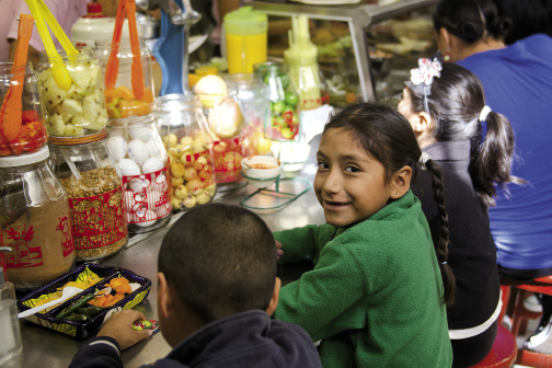 Children play into the night and treat themselves to sweets.