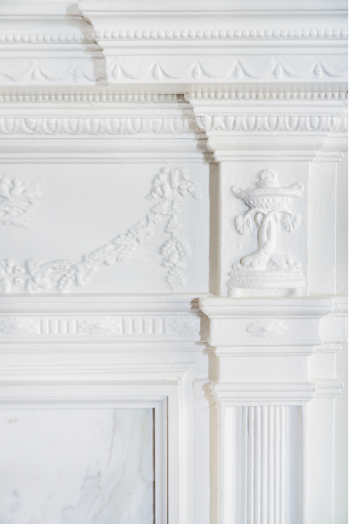 Adamesque-style woodwork was added to mantels in the late 1920s, as was the dining room chandelier—likely Waterford.