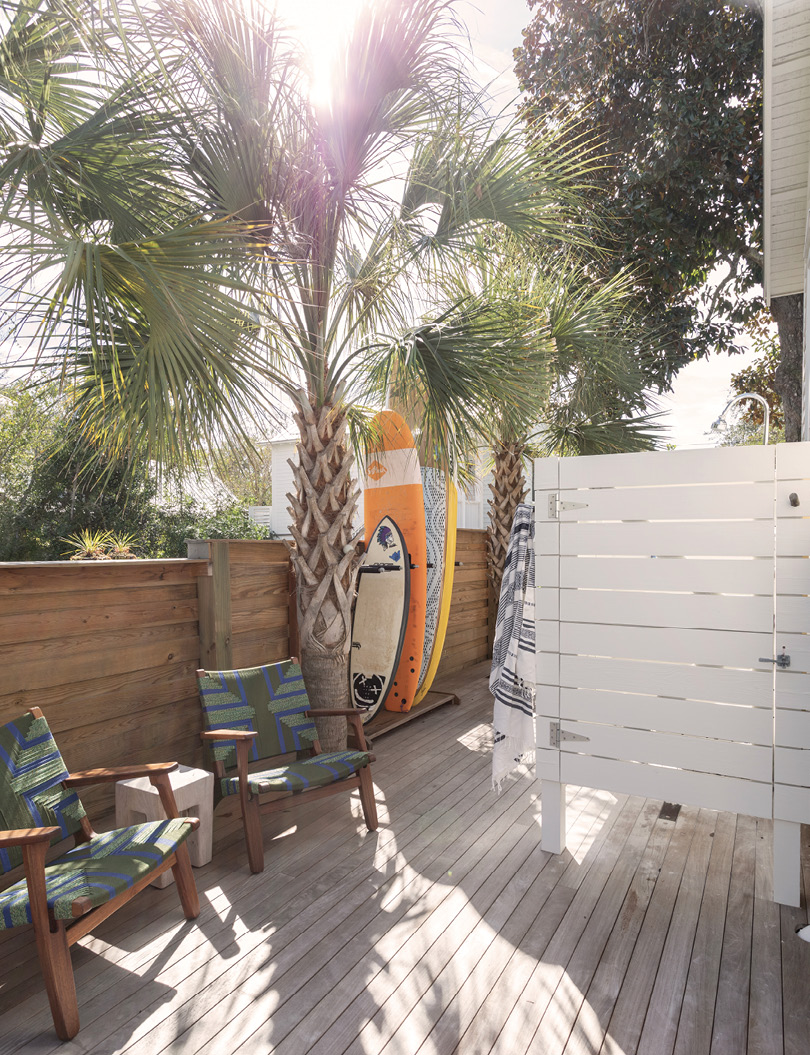 Just outside, a surfboard rack and outdoor shower make it a practical drop zone, too.