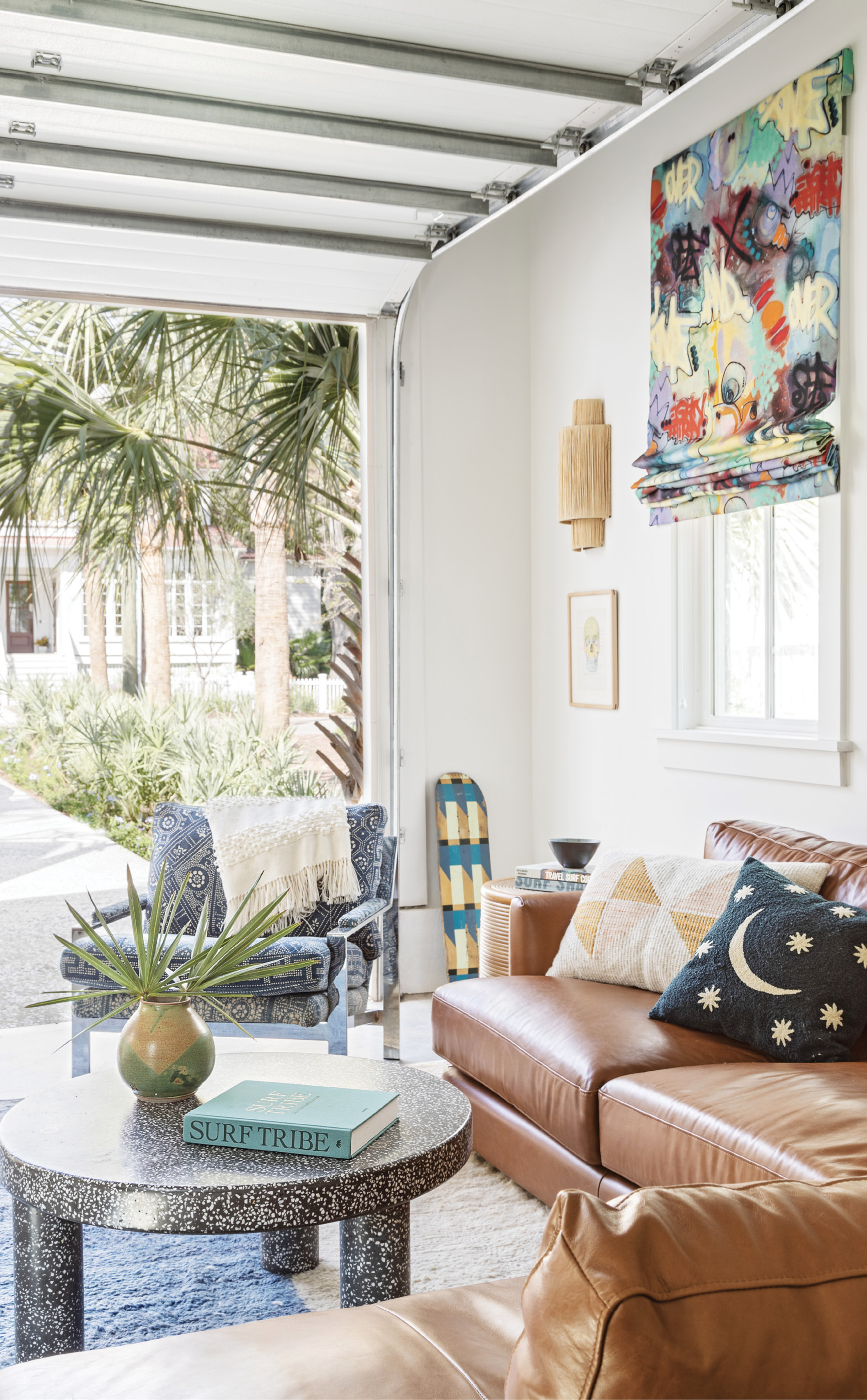 Teen Scene: Stone and leather (in the form of a terrazzo coffee table from Anthropologie and sofa from West Elm) are durable yet great-looking choices for the garage-turned-kids' hang space.