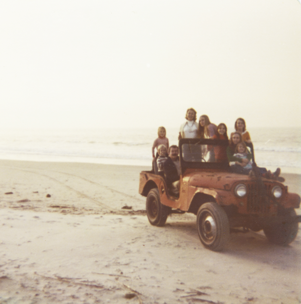 Marshall's dad, Neil, drives the family on front beach jaunts in their Willys jeep.