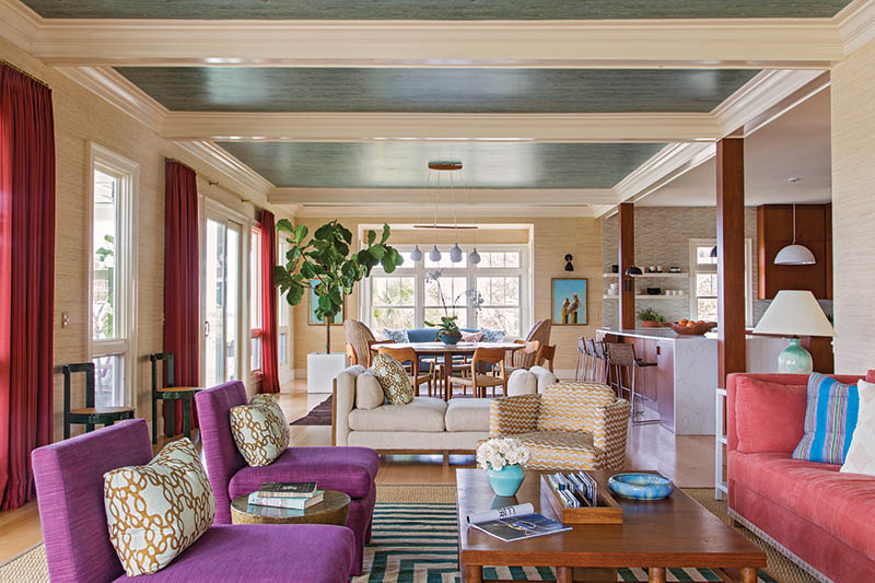 """Beyond Neutral: Airy, relaxed, and """"get me out of my box"""" was owner Rebecca Ufkes's directive to interior designer Angie Hranowsky, who obliged by wallpapering the ceilings in Nobilis """"Faux Bois"""" in a subtle teal green, reorienting the living space toward the water view, and sprinkling in jazzy patterns and hues of purple, orangey reds, and blue."""