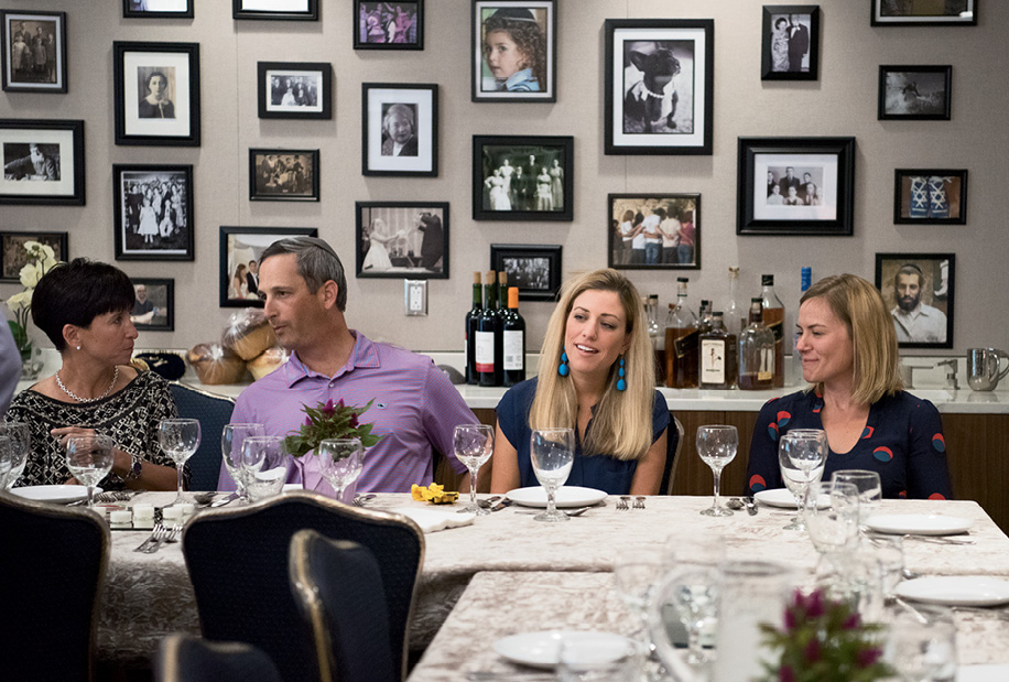 Weekly Shabbat dinners take place in a central kitchen and dining area (complete with gallery walls featuring local families).