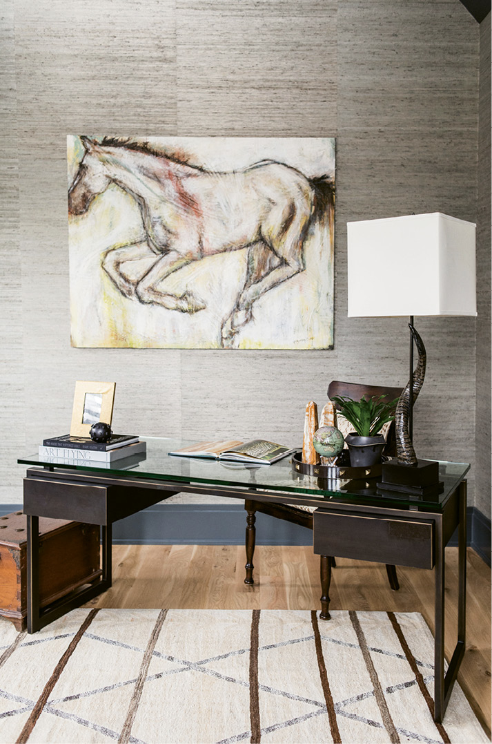 ...with Phillip Jeffries grasscloth-covered walls and desk from Restoration Hardware.