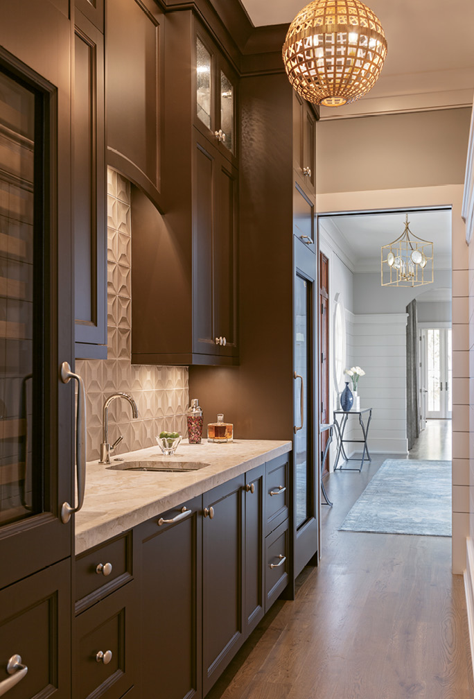 Hidden behind the main kitchen area is an innovative butler's pantry, resplendent with floor-to-ceiling cabinets designed by Robert Paige Cabinetry.