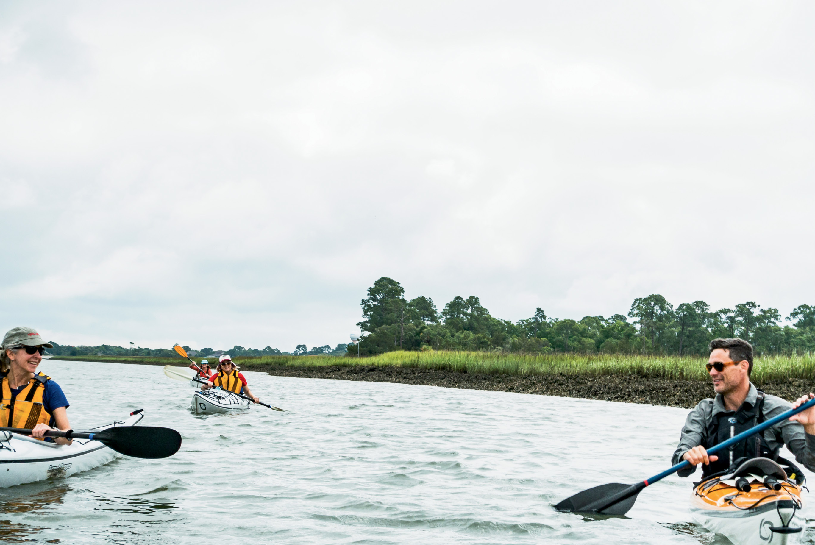 Kayak Farm guide-owner Eric Gibbons leads a group of paddlers through Fripp Inlet.