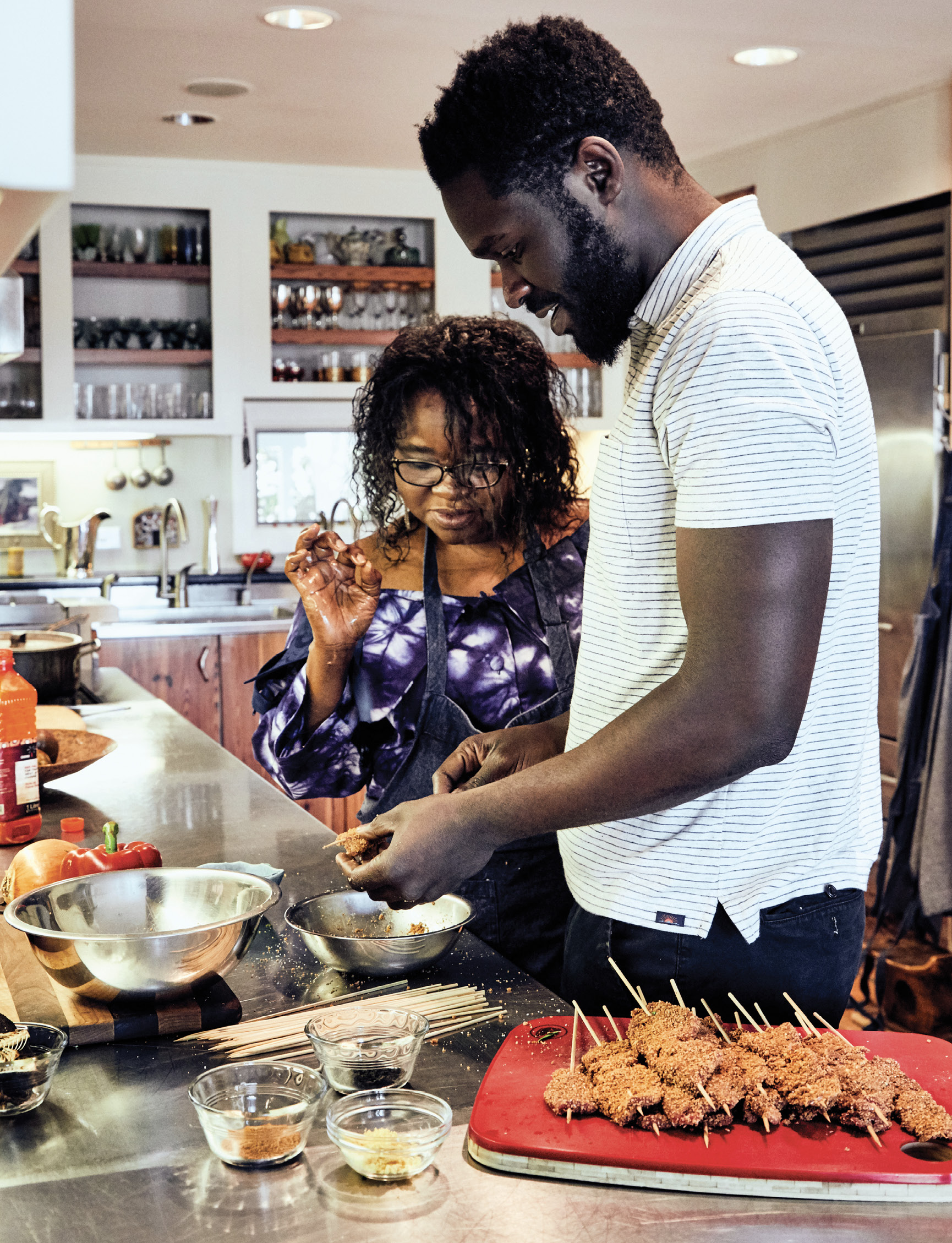 "Though he moved away from Nigeria as a baby, Femi holds an affinity for the Yoruba dishes of his youth. He often seeks his mother's cooking guidance over the phone. ""She always seems to know what I'm about to ask,"" he says."