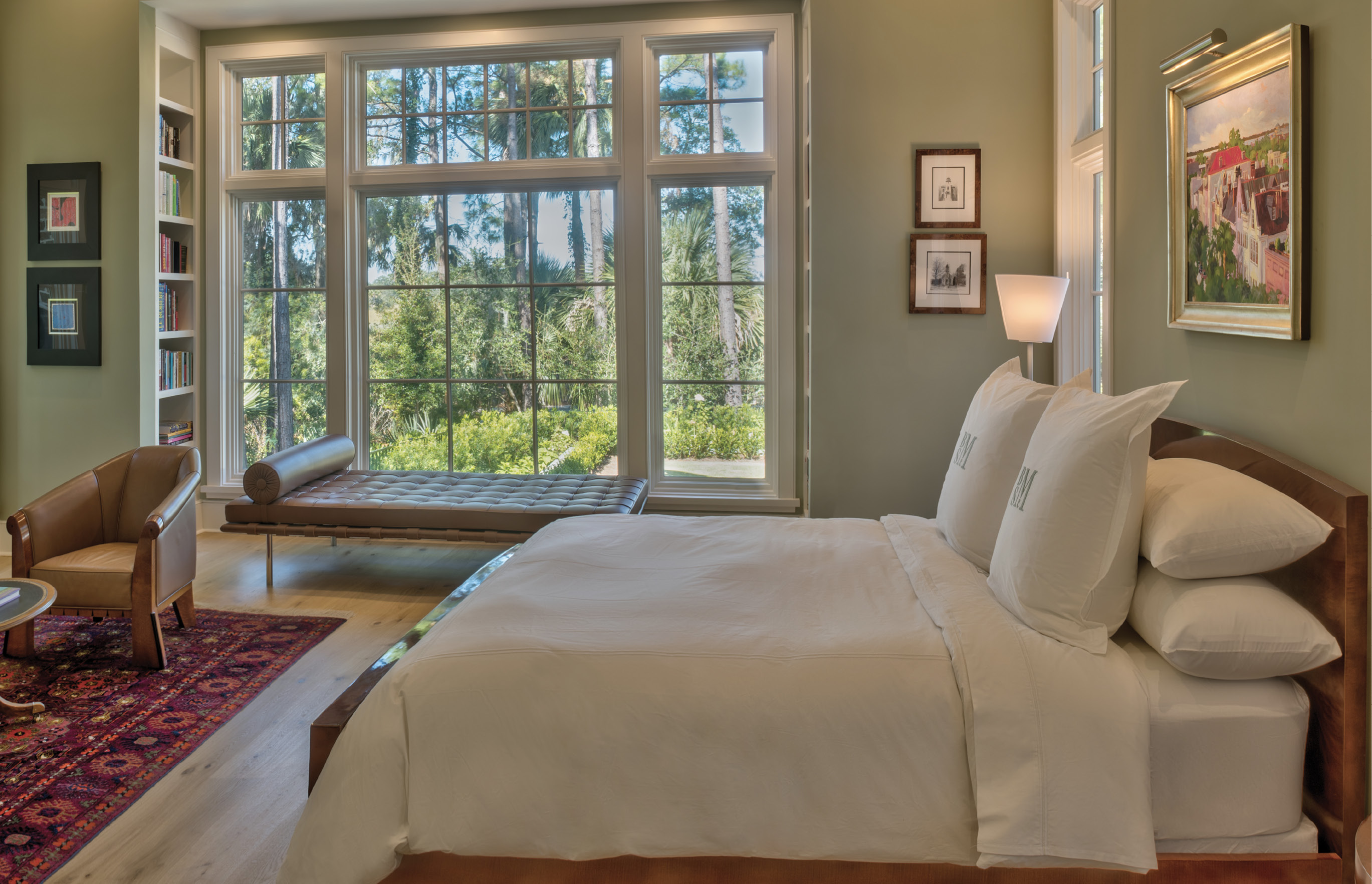 "TRANQUIL RETREAT: Walls throughout the home are white, except for the soothing seafoam green in the master suite. With windows on three sides, the master gets plenty of soft light; ""the beauty when the sun is coming up is very special,"" the wife says."