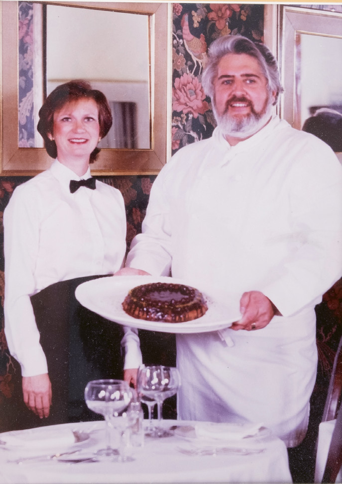 Pam and Robert Dickson in the dining room of their Rainbow Market location