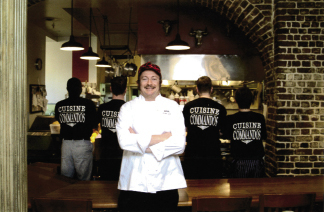 "Lee at SNOB with four of his ""Cuisine Commandos,"" cooks who earn the shirt and the title by demonstrating their passion, skill, and commitment to excellence—""It's an elite club for sure,"" he says."