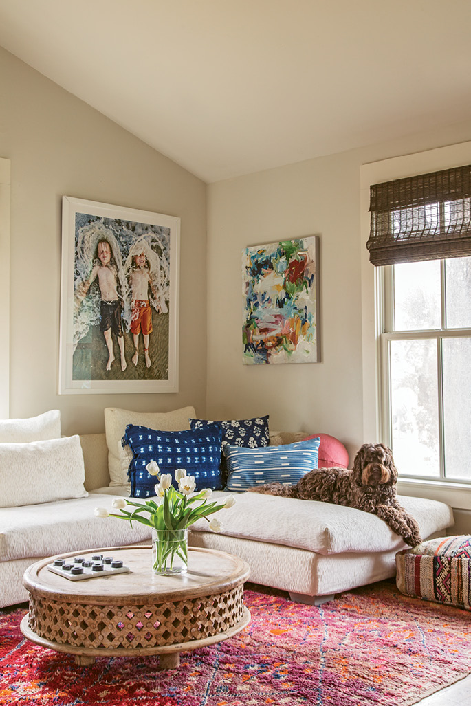 The twins (and Chief) can often be found hanging out on the white Nuevo Home sectional in this den off the kitchen. A round West Elm coffee table pinch-hits as a homework desk. Allison found the rug on a trip to Morocco, and the indigo pillows are from Dear Keaton.