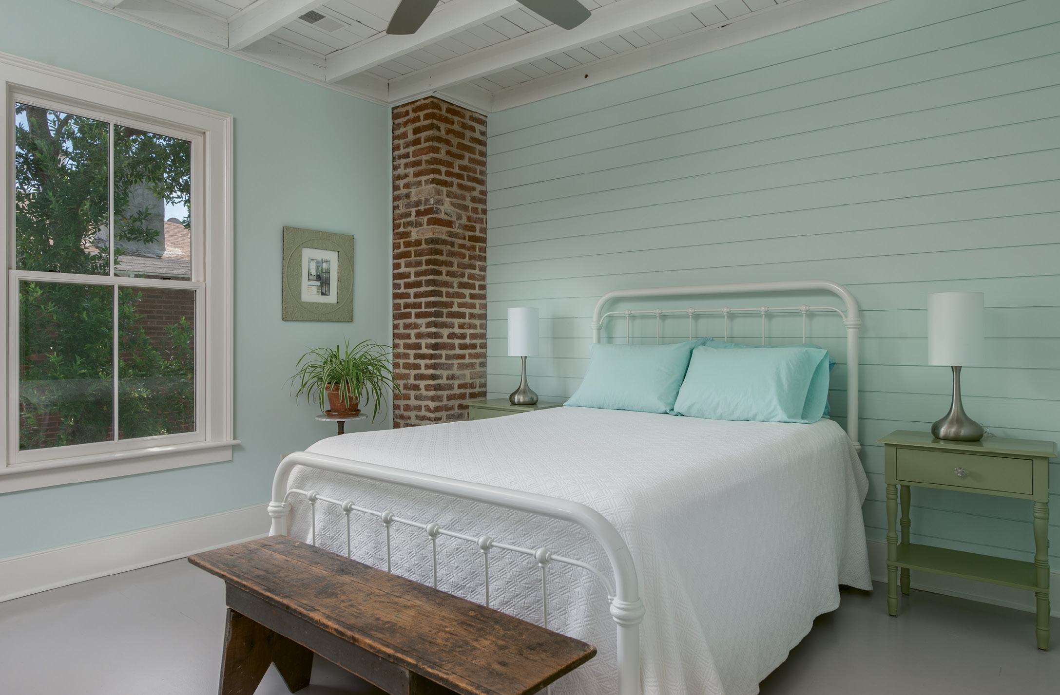 "Shiplap walls in Behr's ""Whipped Mint"" set a serene mood in the master bedroom."
