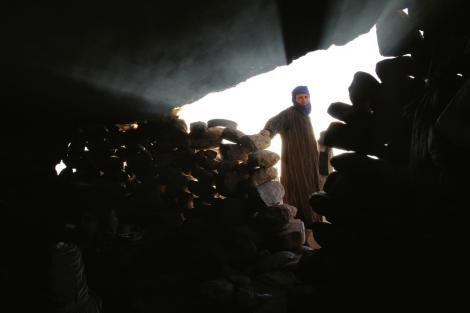 "Inside the cave where the Berber family cooks and sometimes sleeps. ""The energy in Morocco was wild and raw,"" says Barnhardt. ""Your senses are oversaturated with the sights, sounds, and smells—some good, some bad—but every second was worth it."""
