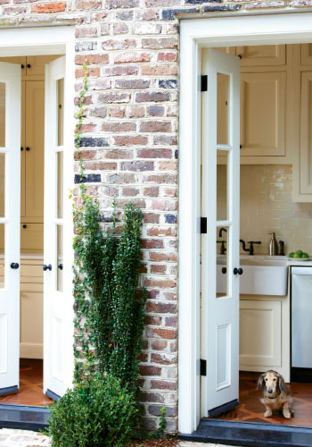 Adding French doors to its galley kitchen opened views to her courtyard garden