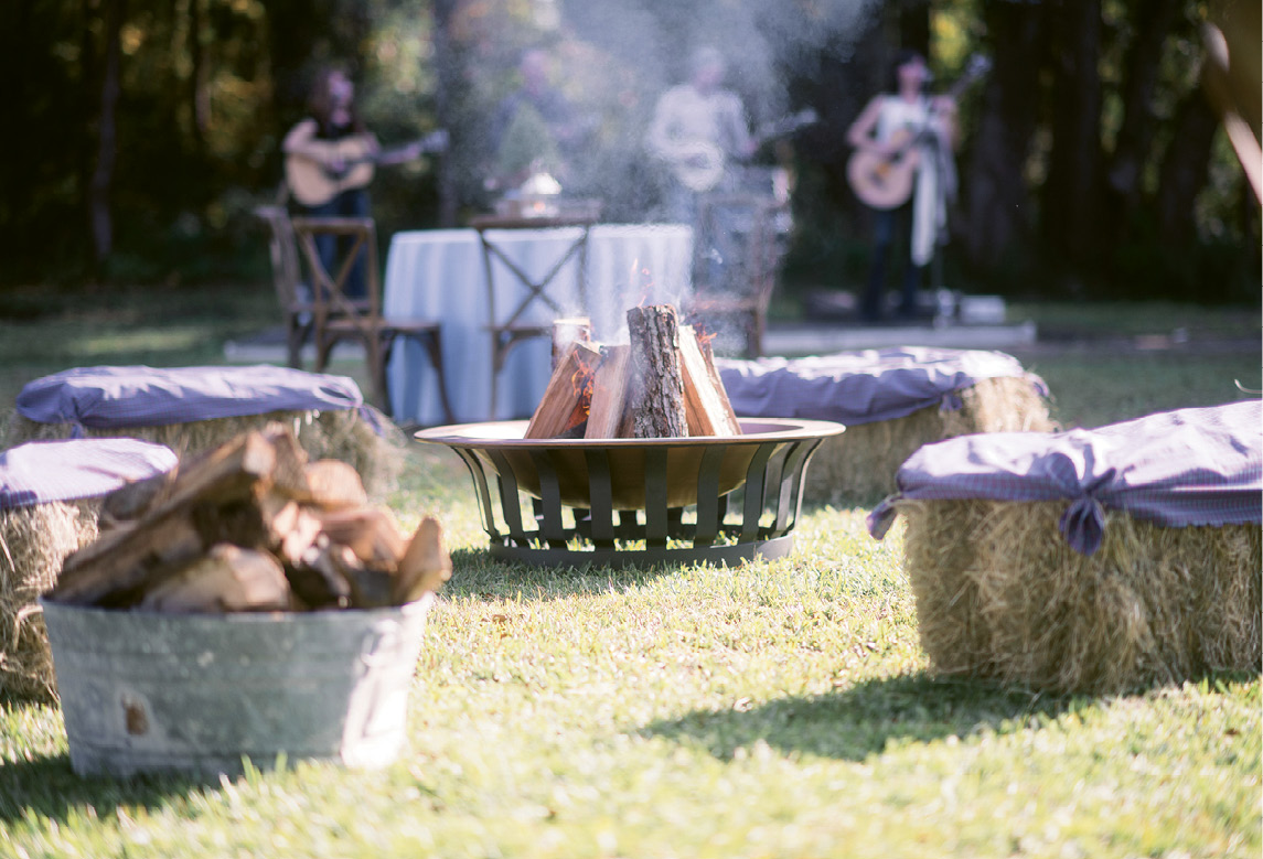 "Down-Home Details: A ""country cool"" dress code ensured guests arrived ready to traipse about the rural venue. Hay bales picked up from a nearby supply store and barrels rented from Snyder Events added rustic charm aplenty."