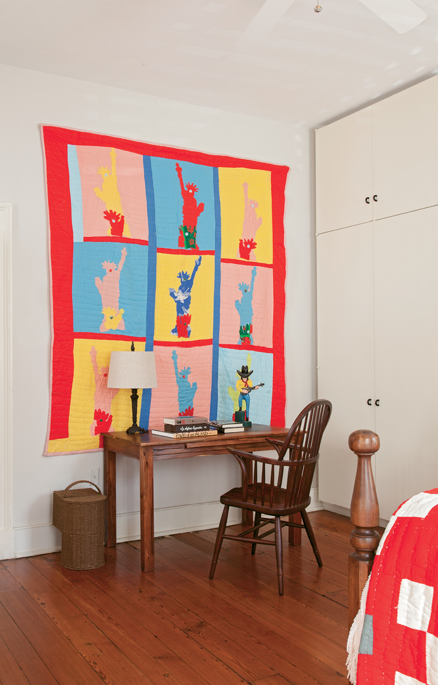Mississippi artist Sarah Mary Taylor's Statue of Liberty hand-sewn cotton quilt brightens up a simple wooden desk.