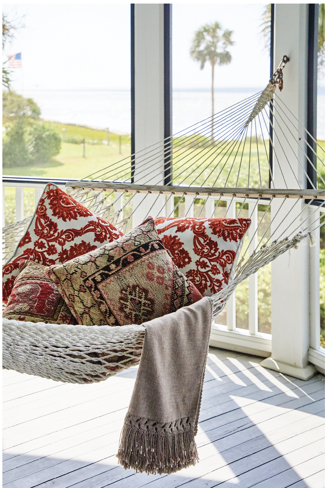 Plump pillows and a soft throw make this hammock an enviable post-meal napping spot.