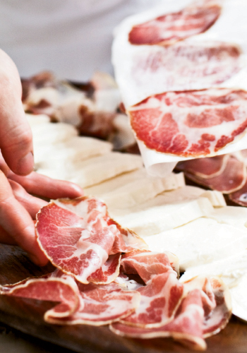 Ask your butcher to place thin slices of cured meat on deli paper so it won't stick together.