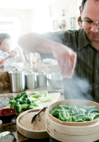 While the boys work, Marc steams some edamame for everyone to snack on as the main course cooks.