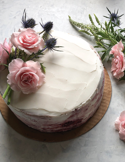 An almond-flour cake with strawberry jam filling and almond-coconut buttercream