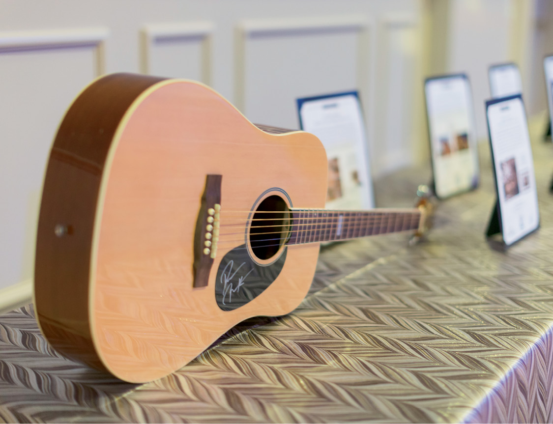 "Darius Rucker signed a guitar as part of the live auction package ""A Little Bit Country, A Little Bit Rock'n'Roll."""