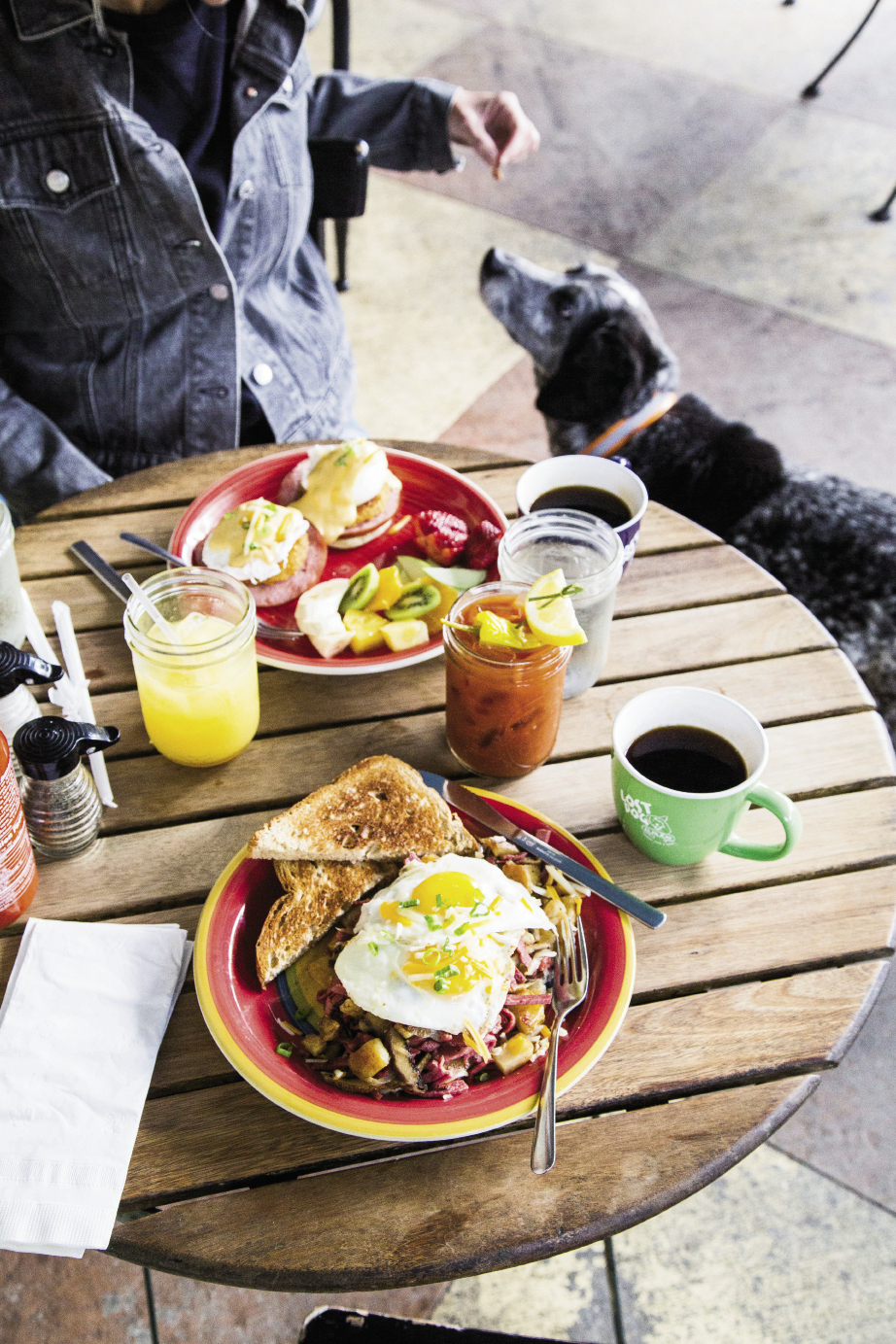 "Favorite brunch picks at Lost Dog Cafe—a pooch-friendly spot (at outdoor tables only)—are corned-beef hash and eggs and the eggs Benedict. Don't forget the ""licker"" drinks, house-made Bloody Marys and Mason Jar Mimosas."