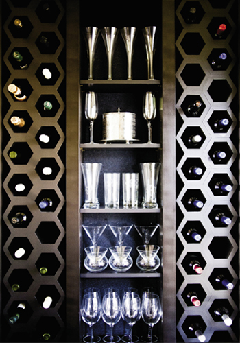 Keeping Cool: A wet bar off the kitchen features built-in hexagonal wine storage.