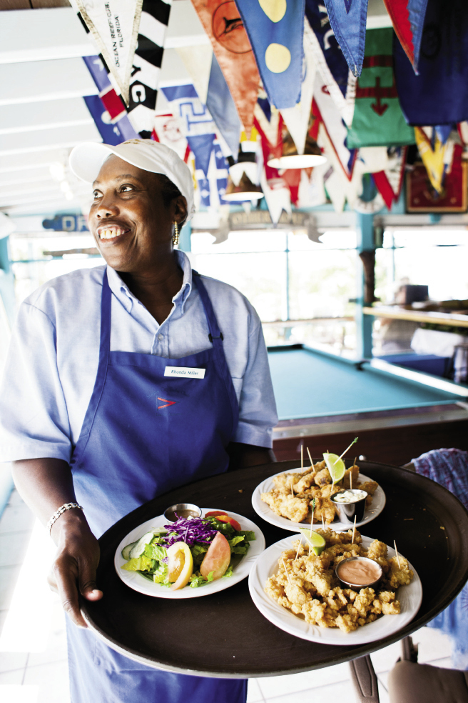 Big plates of fried fish and conch fritters are served all day at the Staniel Cay Yacht Club. Staniel Cay has its own airport