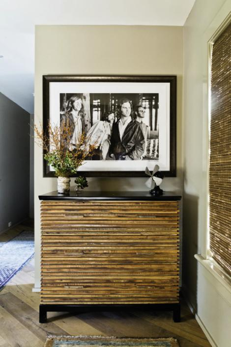 Rock the House: A black-and-white photo of The Doors by Henry Diltz hangs over a Brazilian wood chest by Environment in the foyer.