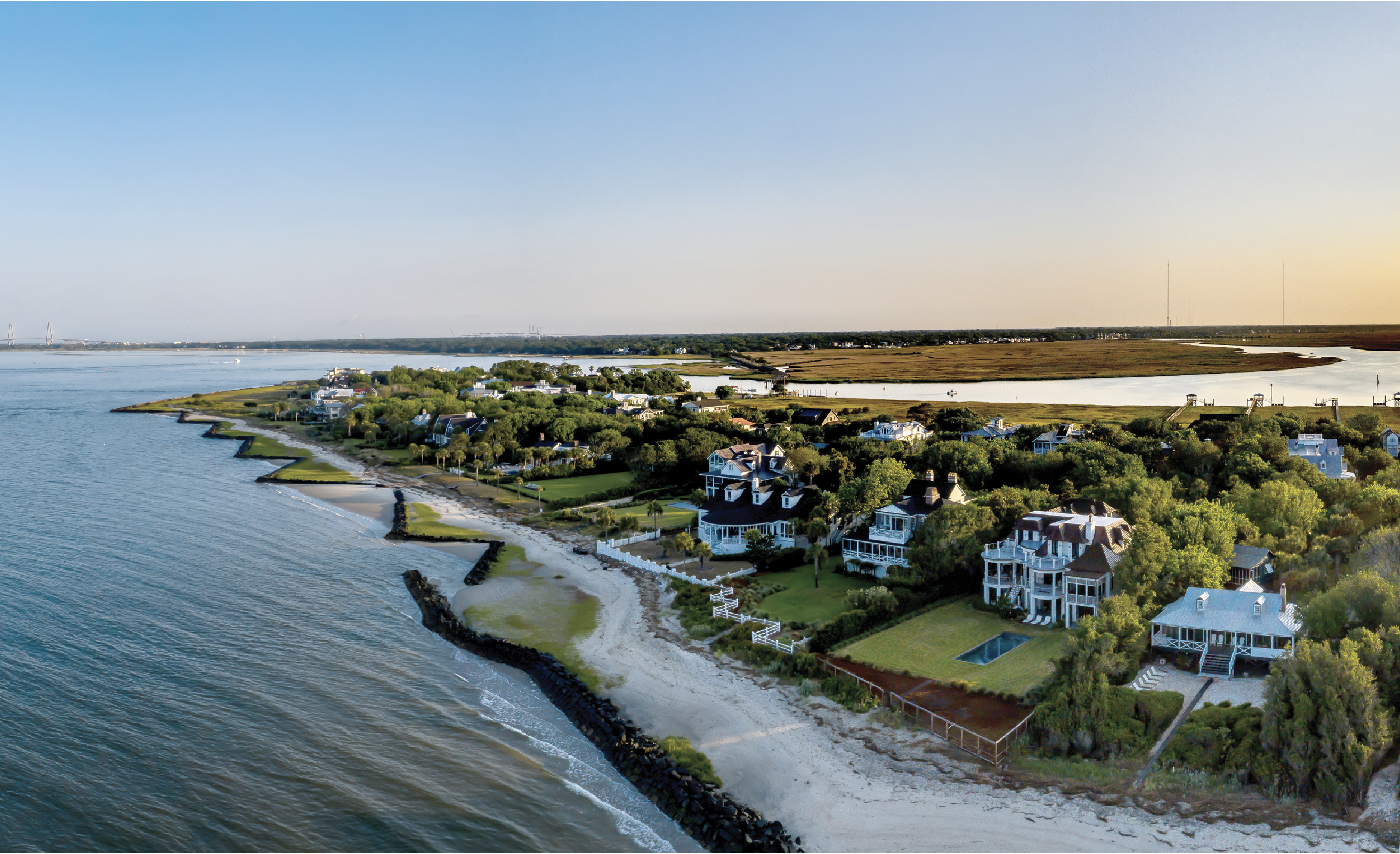 The southern tip of Sullivan's near Fort Moultrie curves to the Intracoastal Waterway, with Mount Pleasant's Old Village on the far side. There, a trolley bridge across Cove Inlet once connected summer residents to the island.