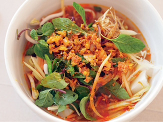 "Homemade Eats: ""I love making khao poon for my family. It's a red curry coconut milk soup. Banana flowers really make the flavors pop."""