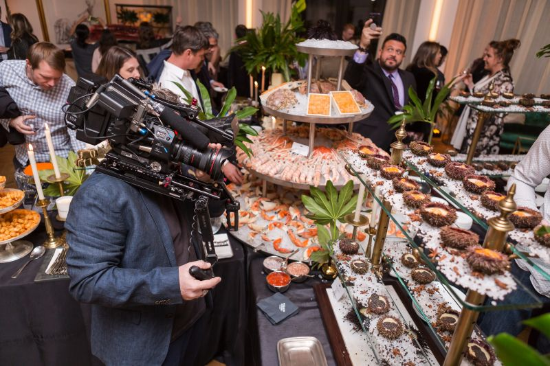 The Man Vs. Food film crew takes in the endless spread.