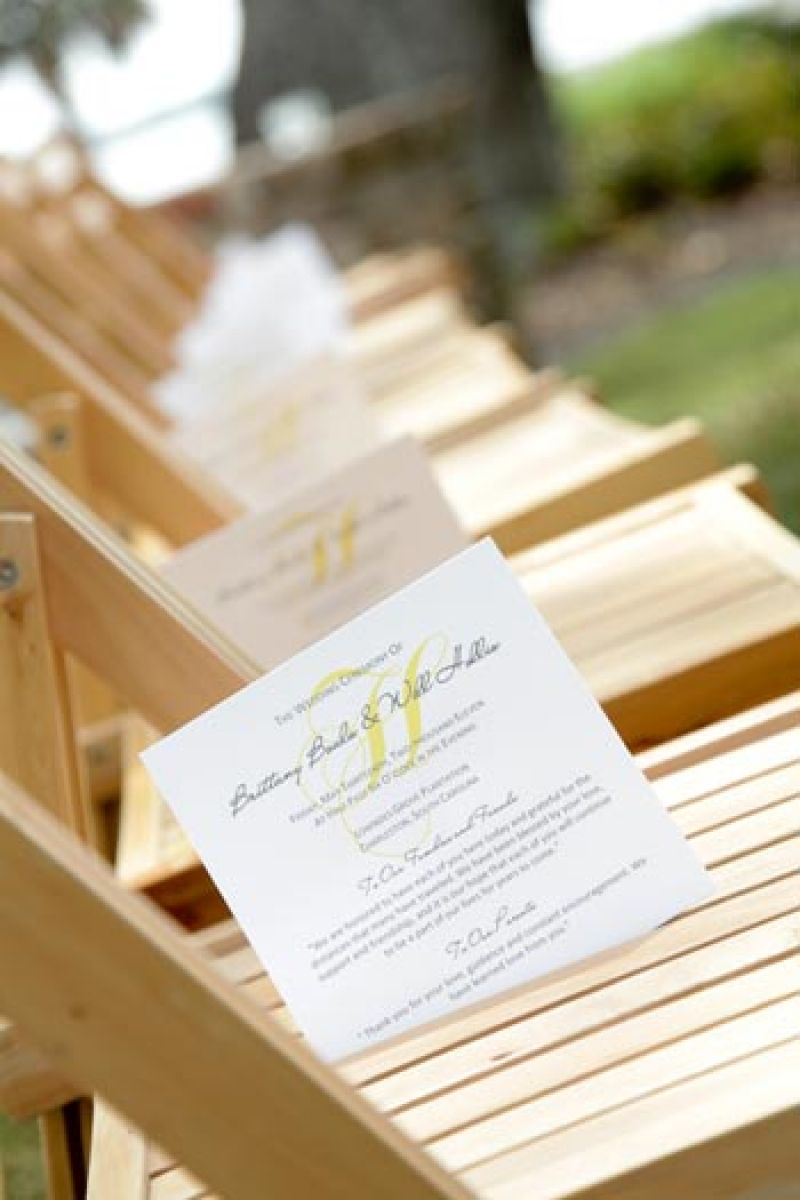 SUITES AND SEATS: Scotti Cline Designs crafted ceremony programs that coordinated with the color scheme.