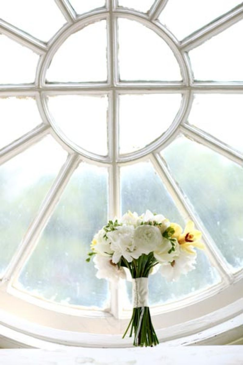 PRETTY AS A PICTURE: A top-floor window in the mansion is a great perch for brides and bouquets alike to pose for portraits.
