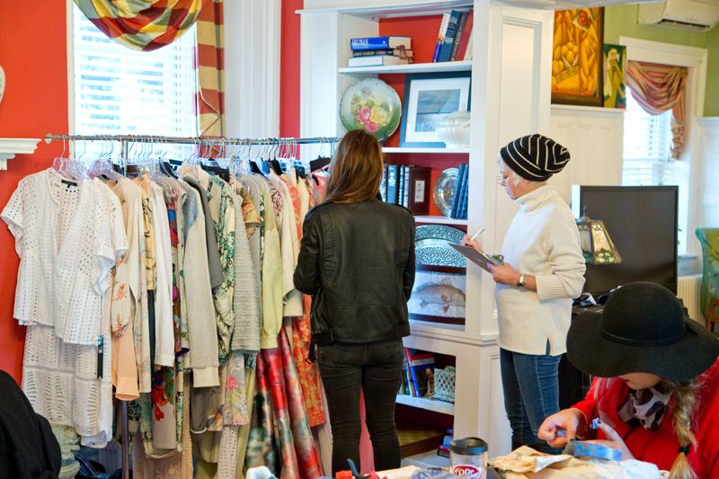 Stylist Holly Gray and photographer Caroline Knopf reviewing the wardrobe; photo by Mac Kilduff