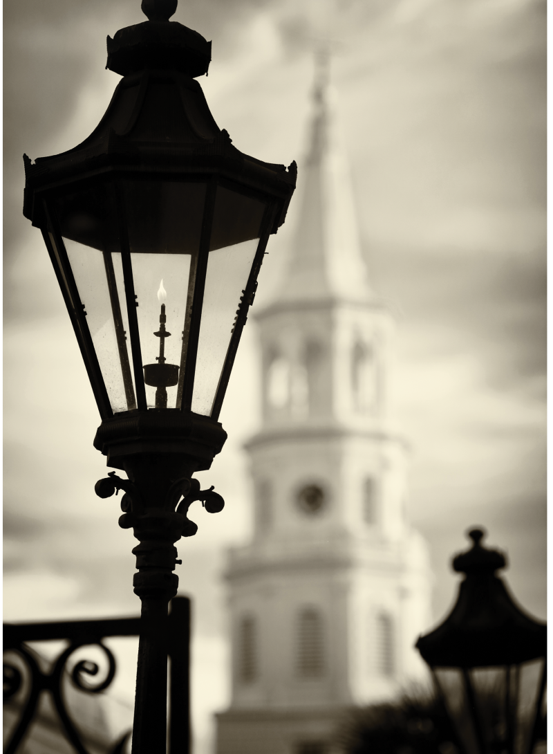 Gaslight lanterns at Hibernian Hall frame the iconic Saint Michael's Church.