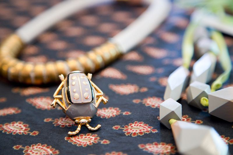 Beetle ring and necklaces from Cynthia Rowley; photo by Mac Kilduff