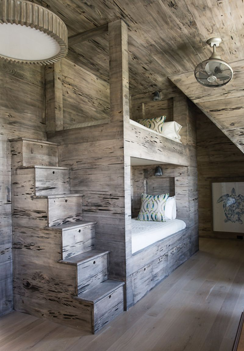 "Wood Works - North Carolina-based interior designer David Smith employed many organic elements in this beach house, including pecky cypress throughout the bunk room for a more relaxed feel.  Location: Isle of Palms (owned by Mary and Mike Lamach) Issue: June 2018, ""Home Away""  Photographer:  Julia Lynn"