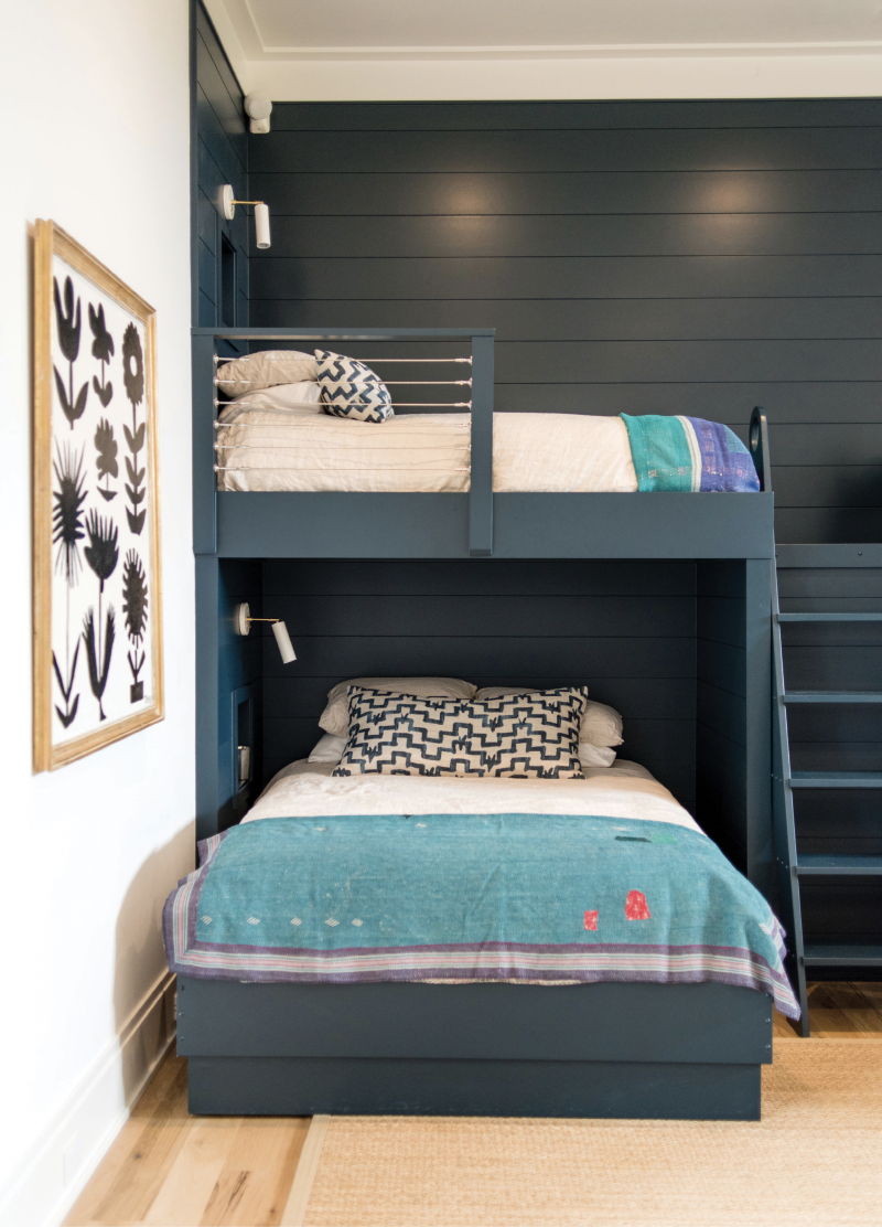 "Ship Shape - To add unifying color and interest—not to mention make cleanup a breeze—interior designer Hollis Erickson had the bunk wall covered in ship-lap and painted it all ""Hague Blue"" by Farrow & Ball.  Location: Daniel Island  Issue: July 2019,  ""High-Style Haven""  Photographer: Marni  Rothschild Durlach"