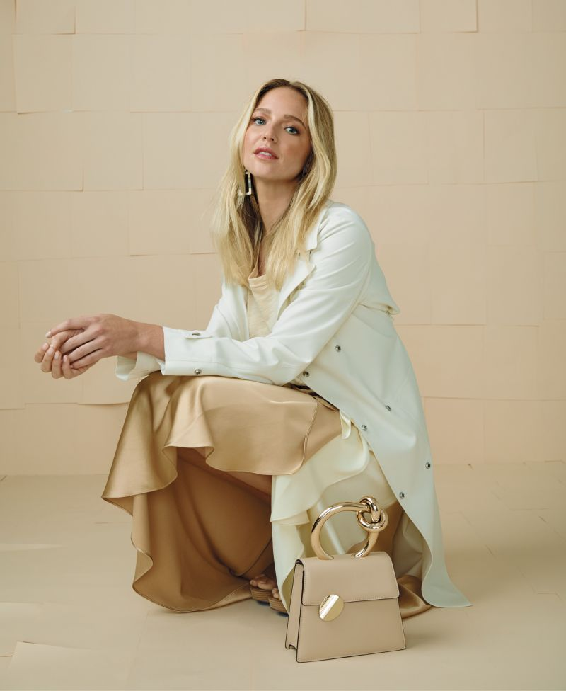 """Vanilla Sky - Theory trench coat, $795 at Gwynn's of Mount Pleasant; Wishlist """"Everyday Tee,"""" $36 at House of Sage; Alejandra Alonso Rojas """"Maite"""" midi two-tone skirt, $1,095 at RTW; Sheila Fajl """"Double Rectangle"""" earrings, $64 at Rhodes Boutique; Benedetta Bruzziches """"Brigitta"""" small bag in """"Ostrica,"""" $698 at Finicky Filly; Pelle Moda """"Parker"""" leather heels in """"taupe,"""" $175 at Shoes on King"""